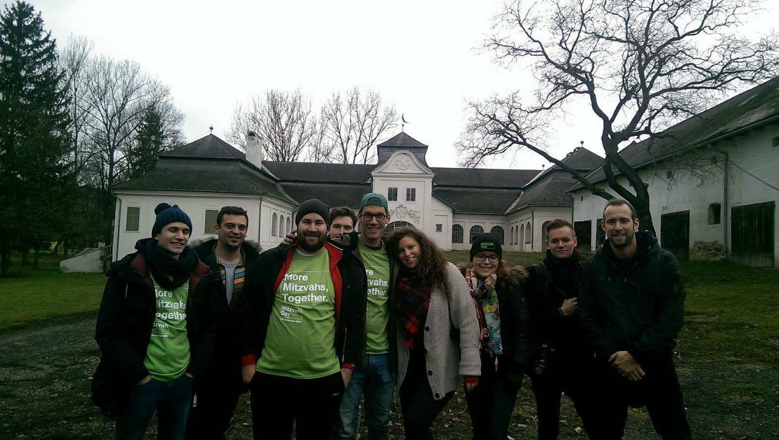 Budapest - Volunteers in Hungary cleaned a garden and delivered toys to an orphanage