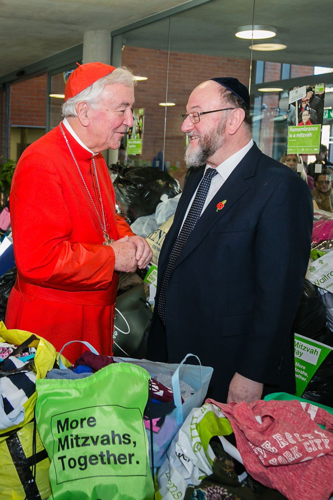 Cardinal Nichols and Chief Rabbi sort clothes for the homeless at South Hampstead School - picture by Yakir Zur