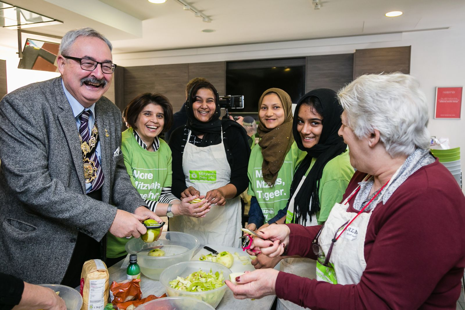 Mayor of Camden cooking for the homeless with Mitzvah Day founder Laura Marks and Jewish and Muslim volunteers at JW3 - picture by Yakir Zur