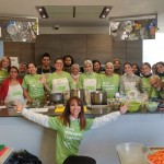 Mitzvah Day interfaith chair Daniela Pears with Sikh, Muslim and Jewish volunteers cooking for church shelter at second JW3 cooking event