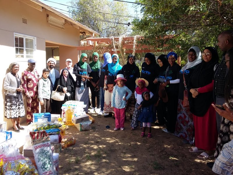 Namibia - Members of Bahai, Christian, Redemption Church, Islam and Judaism on a community food drive, taking a convoy to orphanages