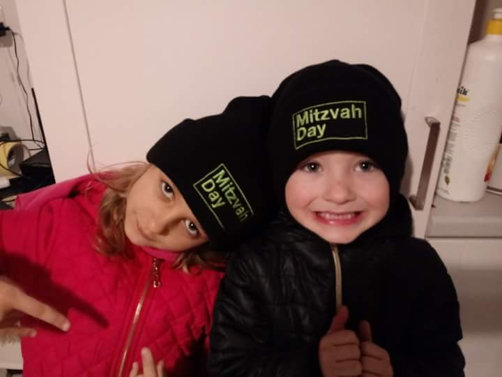 Poland - Two young children from the Cukunft Jewish Association take part in Mitzvah Day in Poland