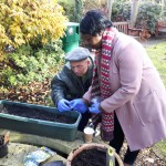 Staff and residents at Jewish Care's Sidney Corob House tend the gardens of Marie Curie Hospice, Hampstead