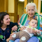 Three generations meet as Apples and Honey Nursery visit Nightingale House care home in Clapham - picture by Yakir Zur
