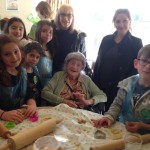 Woodside Park Cheder pupils visited Jewish Care's Rubens House on Mitzvah Day - resident Hilda Pressman is pictured alongside her daughter and granddaughter